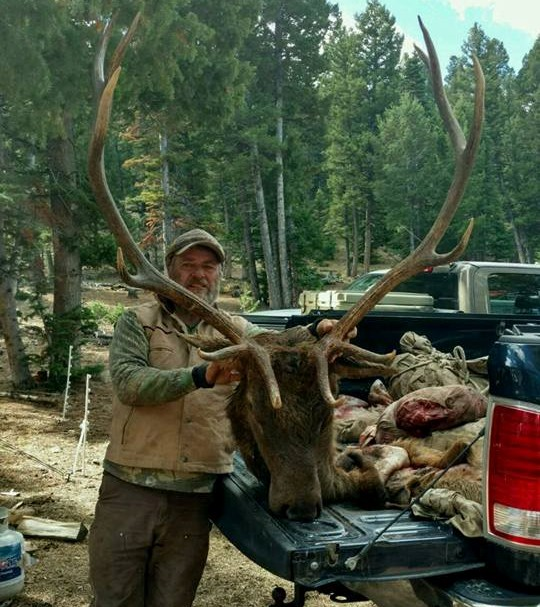Hunter with Elk Head